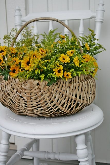 wicker basket full of flowers . . . yellow black eyed susans (?)