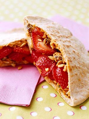 Peanut butter keeps the raisins, berries, and sunflower kernels from falling out of these energy-packed pockets.