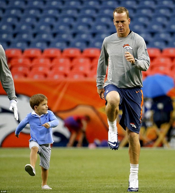 Walk it out: Young Marshall was just one of the guys during stretching drills at Sports Authority Field at Mile High before the game