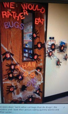 """Door for Drug Free week: """"We would rather eat bugs that do drugs!"""", decorated with spiders, webs, and pictures of students eating gummy worms"""