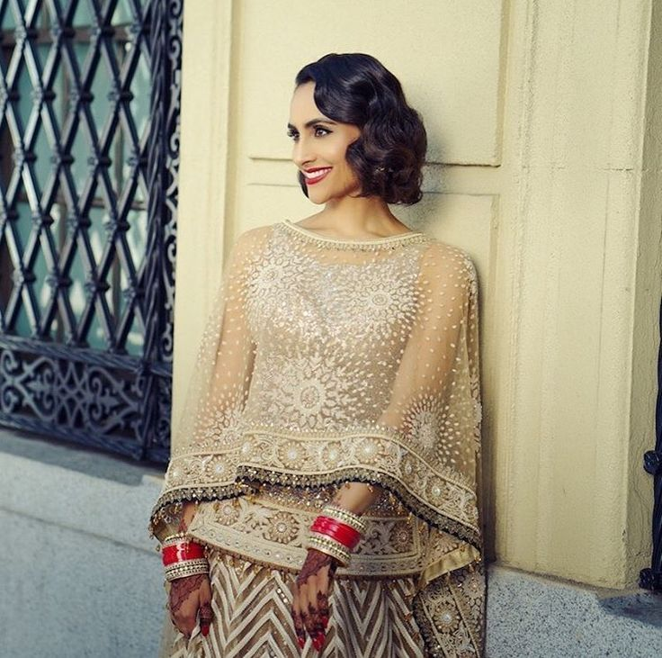 Beautiful bride rocking neutral tones with a pop of red! This look screams classy! Captured by Deostudios.