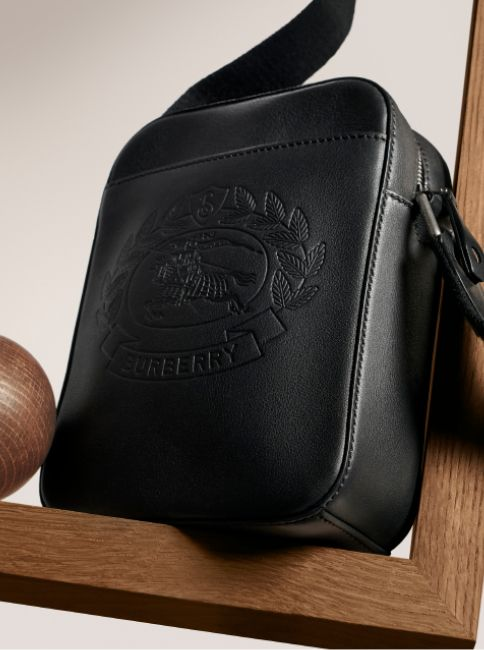 01bdce1c762b Small Embossed Crest Leather Crossbody Bag in Black - Men in 2019 ...