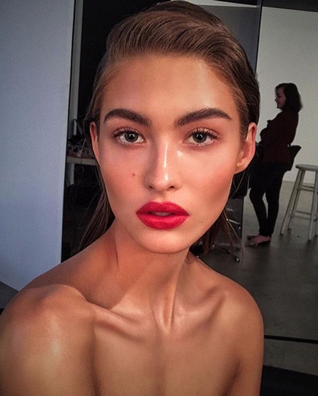 Go bold with a classic red lip, groomed brows and slick bun