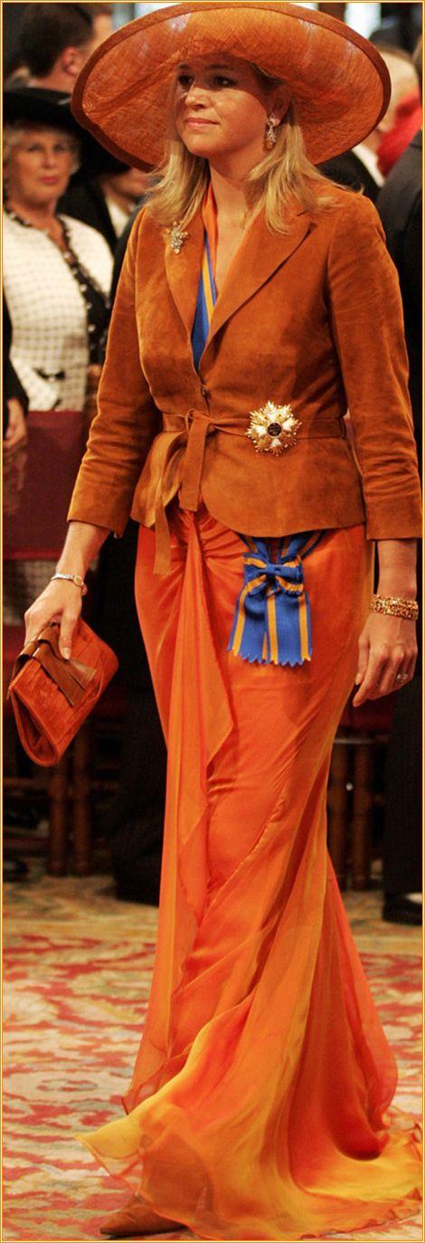 Maxima ~ wearing fashionable orange on Budget Day