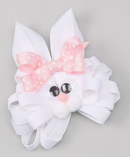 Dress little darlings in spirited ensembles with this hippity-hoppity hair bow that's fashioned with a cheerful bunny face.