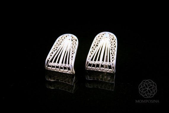 Glamorous geometric woven filigree earrings in ultra-thin threads of the finest grade silver made in Bolivar, Colombia, South America.