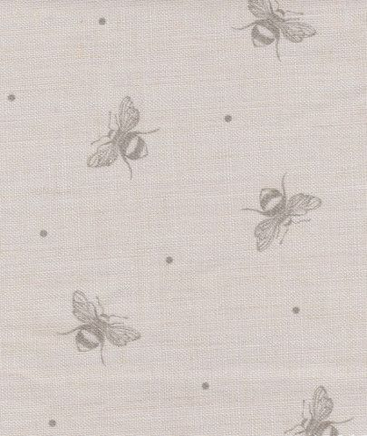 Busy Bees (mink grey) by Peony & Sage.  I love the combination of soft grey and pink for girls' bedrooms - use this fabric to accessorise as lampshades or cushions, or it's perfect for roman blinds and curtains.  Available to order from Victoria Clark Interiors.