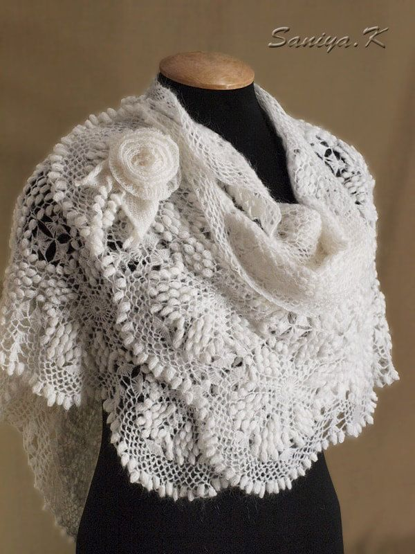 White Shawl crocheted by SaniyaK on Etsy. The crocheted white shawl is made of showy hexagonal motifs. Included is a brooch...