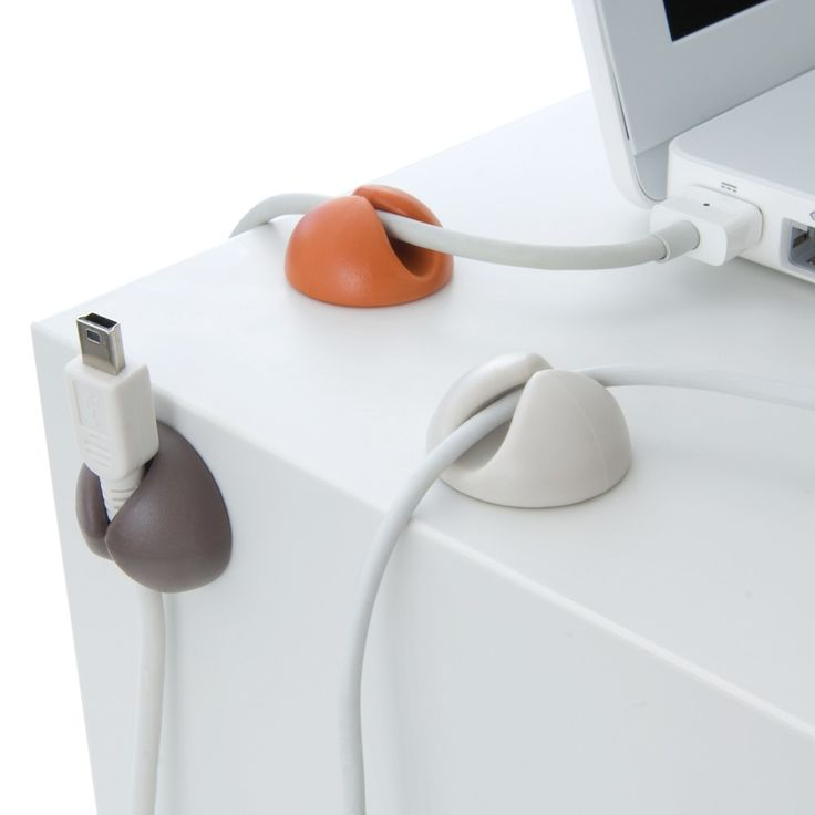 These handy cable organizers easily attach to any surface, whether on the desktop or behind the table.