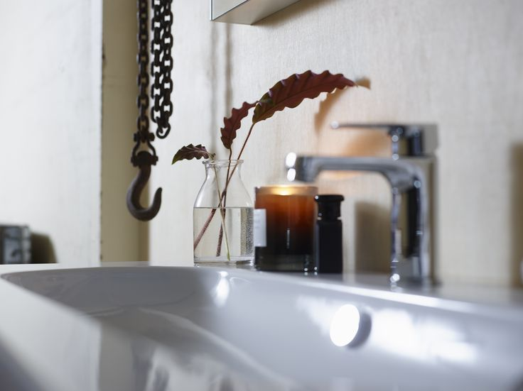 Oval shaped ceramic basin Miller bathroom furniture.
