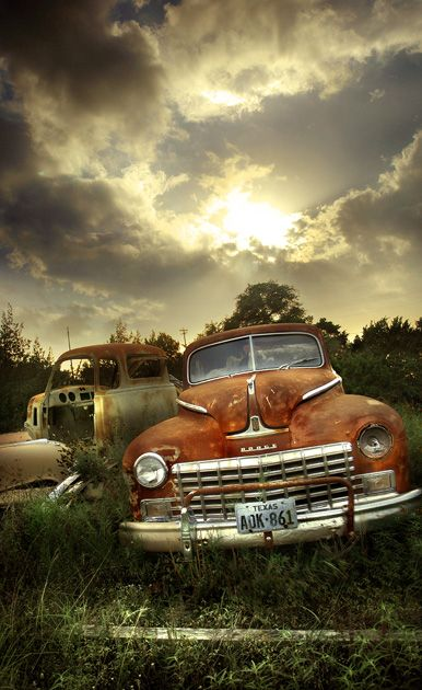 I love old cars and especially old trucks and the angle of the shot and colour of the  clouds... Superb.......