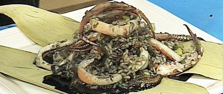 Risotto negro con mariscos y hongos en salsa de jengibre y lima