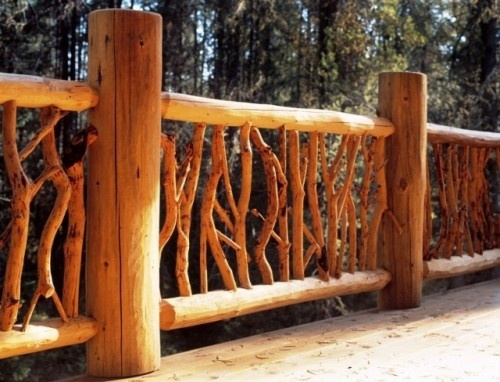 Now THIS is the railing I'd like to have on our front porch..... perhaps even the back as well.