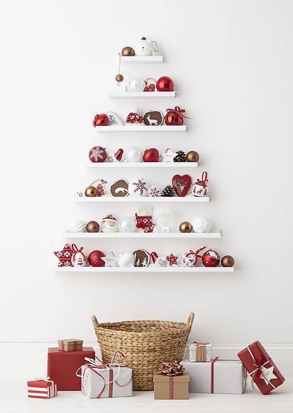 Create a stylish Christmas display with decorations from Homebase. Put up shelving in the shape of a Christmas tree and carefully arrange festive decorations in reds, whites, wood and copper tones.