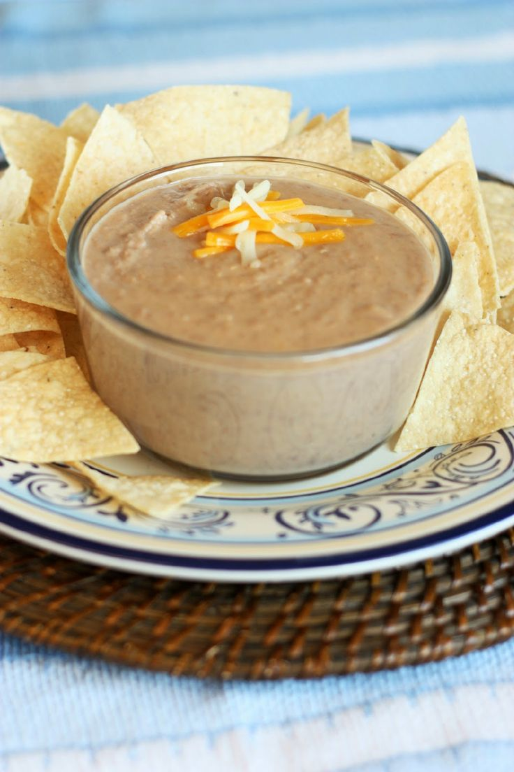 Cheesy Refried Bean Dip.   The best Cheesy Bean Dip is served at 'Acapulco Restaurant in Alameda, CA. O Please let this be like it .....