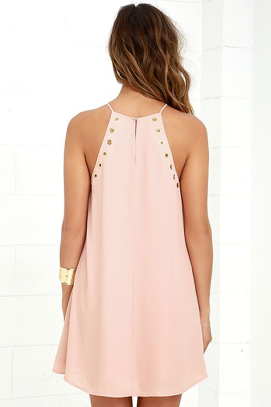 The grommet trend is here to stay thanks to the Amara Blush Swing Dress! This sleeveless, woven dress has a strappy halter neckline, and wide arm openings trimmed in gold grommets. Classic swing silhouette ends at a flirty hem. Back keyhole with top button.
