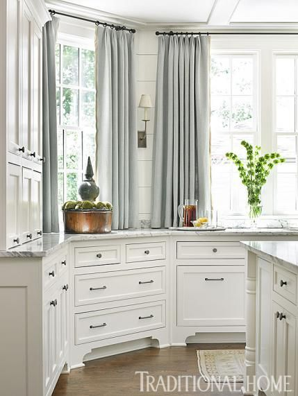 Drapery panels are an unexpected touch in the kitchen and make the room seem lighter and brighter.  - Traditional Home ® / Photo: Emily Jenkins Followill / Design: Lauren DeLoach
