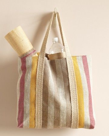 Stock this durable, beach-bound tote with goodies for your weary travelers -- but first, ask your bridesmaids to help you make them. Cut 3 feet of fabric, sew a 1/2-inch hem on each end, and stitch on jute braided trim (mjtrim.com) to create handles. Finish by sewing edges together, right sides facing in, then turn right side out.
