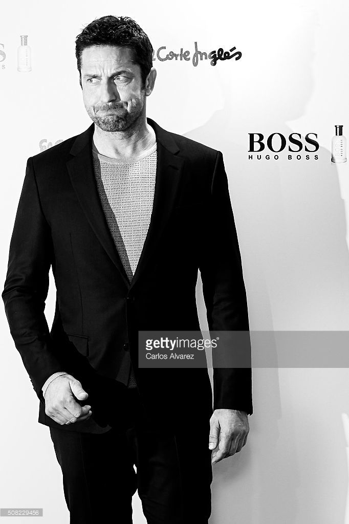 Actor <a gi-track='captionPersonalityLinkClicked' href=/galleries/search?phrase=Gerard+Butler&family=editorial&specificpeople=202258 ng-click='$event.stopPropagation()'>Gerard Butler</a> signs Hugo Boss bottled fragrances at El Corte Ingles Store on February 3, 2016 in Madrid, Spain.
