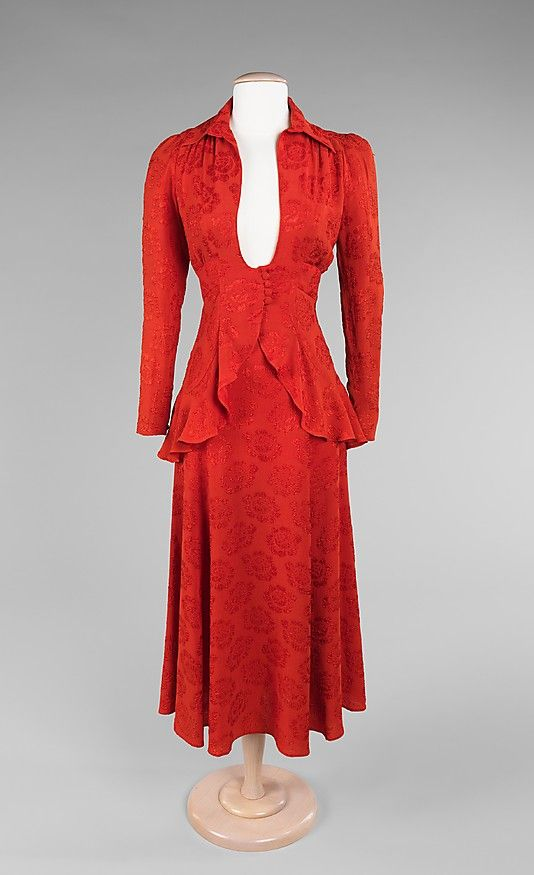 Ossie Clark  (British, 1942–1996)  Date: ca. 1972   Culture: British   Medium: synthetic.  Ossie Clark is most known for his chiffon dresses of mixed prints, designed by his wife Celia Birtwell, but he was also an expert cutter and made exceptional tailored pieces. This suit is a testament to his skill, for the construction and cut allow for a perfect fit, creating a flattering silhouette. The plunging neckline is quite daring, but is a characteristic found in his fresh and innovative work.