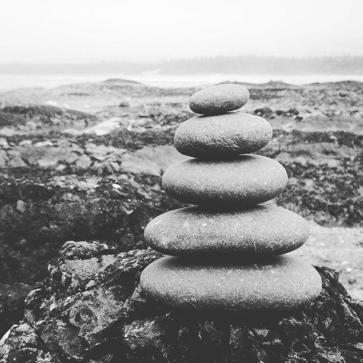 zen // inukshi'kairn // a stack of stones balance on wickaninnish beach pacific rim national park // west coast canada