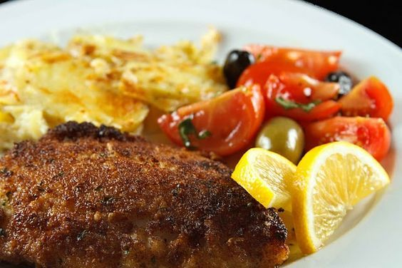 You'll love this Grouper, lightly coated in bread crumbs and pan fried till golden. Served with a tomato-olive salad, simply delicious!