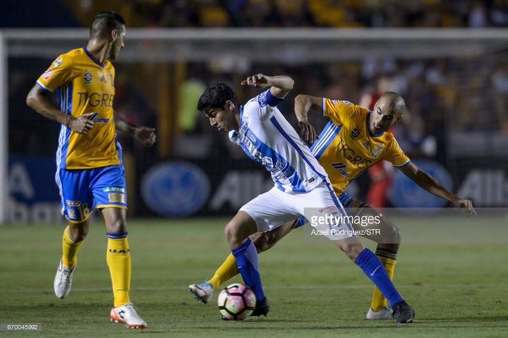 Guido Pizarro of Tigres (R) fights for the ball with Erick Gutierrez of Pachuca (C) during the Final first leg match between Tigres UANL and Pachuca as part of the CONCACAF Champions League 2016/17 at Universitario Stadium on April 18, 2017 in Monterrey, Mexico.