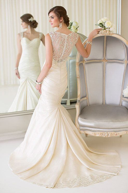 The skirt of this elegant Essence of Australian mermaid wedding gown dons beautiful beaded detail at the hem.