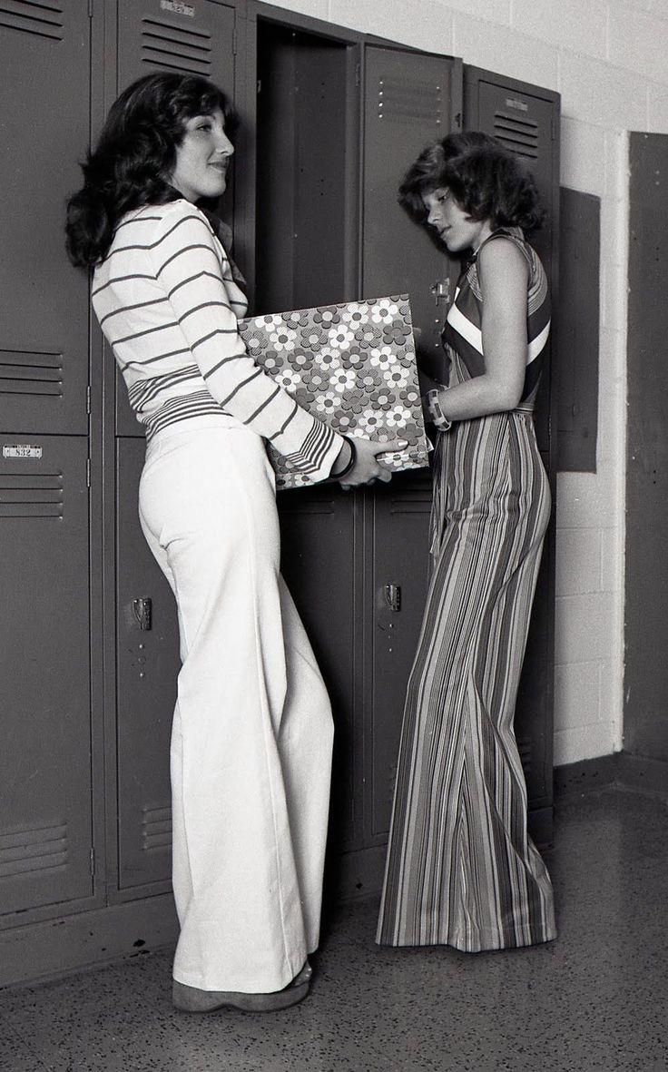 Two girls at their high school lockers, 1970s