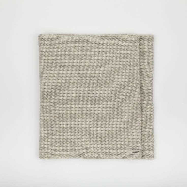 RVLT - men's fashion. Offwhite heavy wool blend snood with knitted pattern to add detail, has the RVLT brand label.