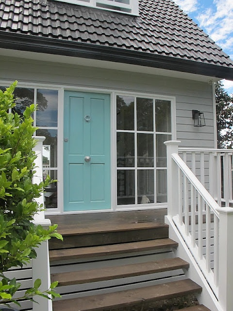 **My inspiration picture! I want to paint the house grey and white with turquoise accents. Love the deck too.
