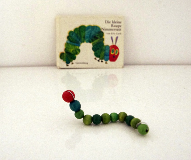 """These beads have been threaded onto a wire ("""",)"""