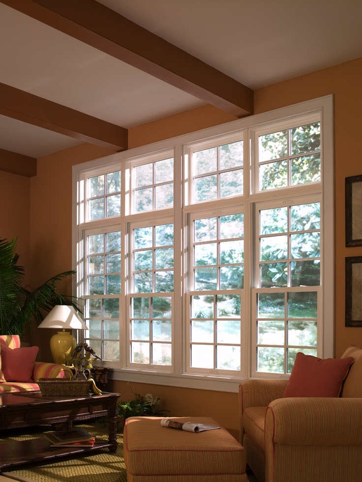 A sunroom or den gets great light with our double hung for Window treatments for double hung windows