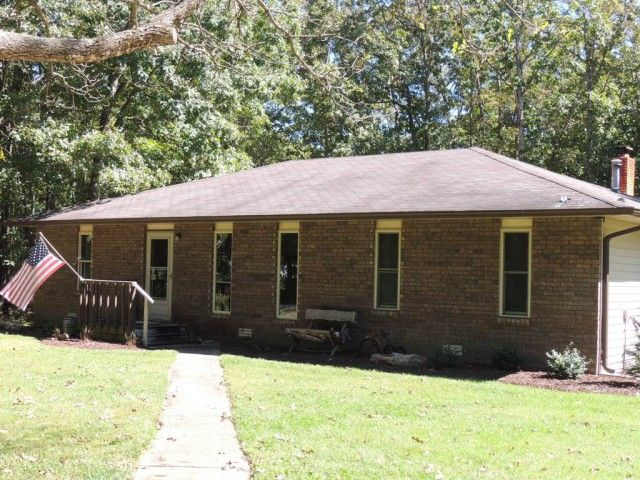 This great home is nestled in the trees on 7.44 acres and accessed by a wooded lane. Many current updates including spray insulation in 2015, water heater