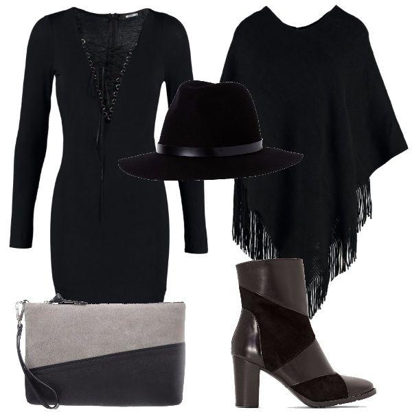 Un outfit alla moda per una donna che non vuole passare inosservata, vestito aderente black con laccetti, mantella , stivaletti e cappello black, pochette grey.