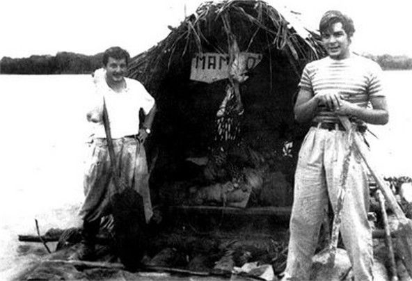 """Guevara (right) with Alberto Granado (left) aboard their """"Mambo-Tango"""" wooden raft on the Amazon River in June 1952. The raft was a gift from the lepers whom they had treated"""