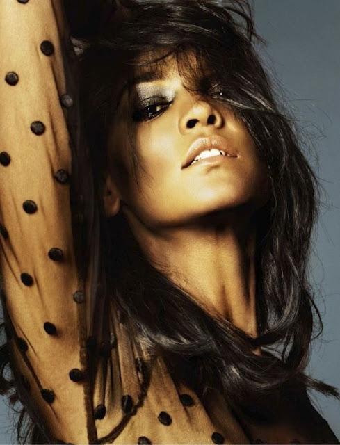 Liya Kebede in sheer black dotted blouse