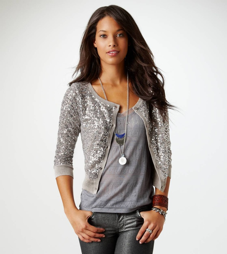 American Eagle Sequin Sleeve Sweater This sweater features glittering sequin sleeves and a stunning overall design. American Eagle Sequin Sleeve Sweater, not normally something I would like? Cooler weather doesn't have to mean boring knits. With sequin-covered sleeves, you can add some dazzle without losing that cozy feeling. See more.