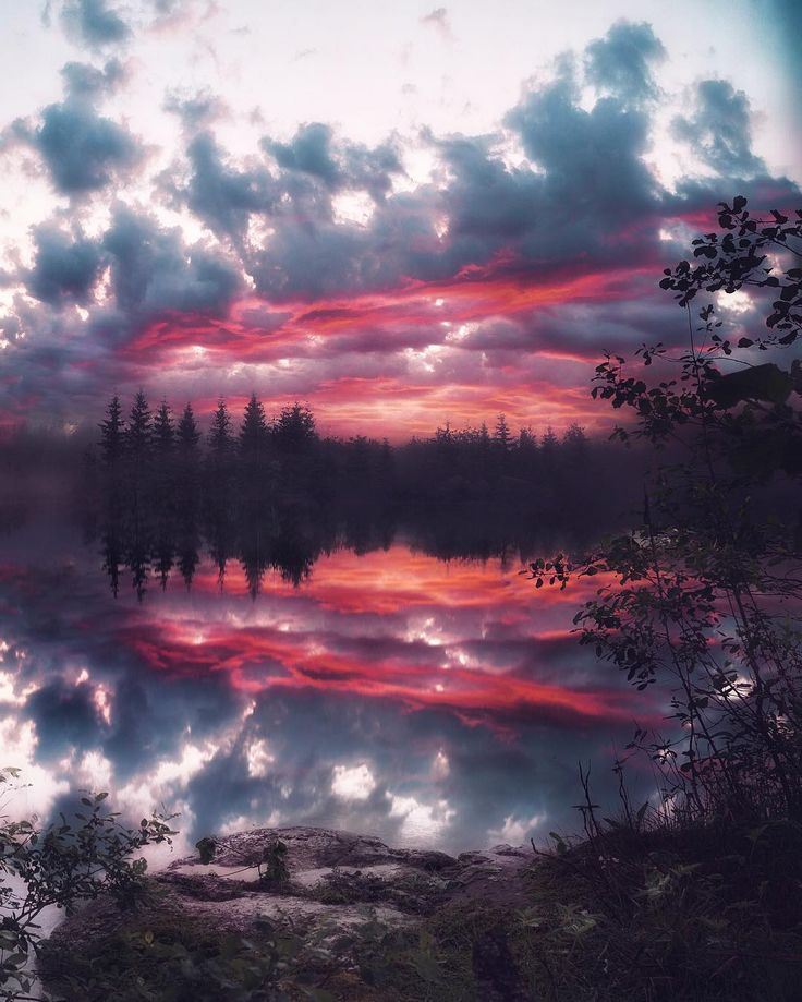 What insane cloud colour... over dead still lake reflections, stunning SkullyBloodrider.