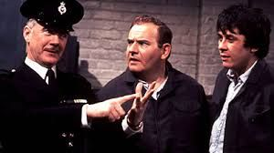"""Porridge is a British situation comedy broadcast on BBC1 from 1974 to 1977, running for three series, two Christmas specials and a feature film also titled Porridge. Written by Dick Clement and Ian La Frenais, it stars Ronnie Barker and Richard Beckinsale as two inmates at the fictional HMP Slade in Cumberland. """"Doing porridge"""" is British slang for serving a prison sentence, porridge once being the traditional breakfast in UK prisons"""