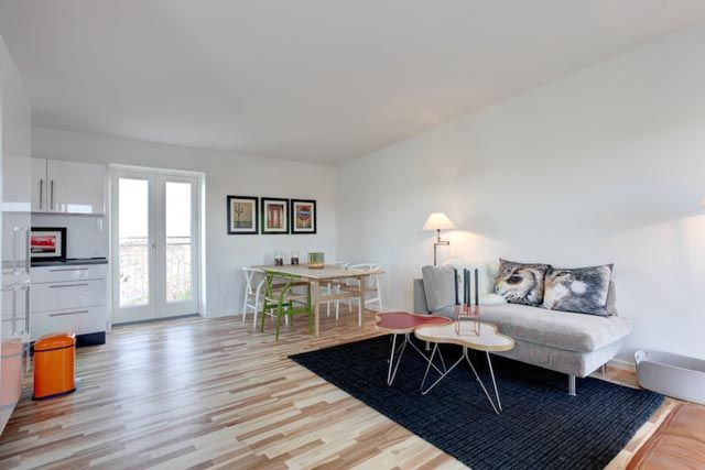 Empty living/diningroom staged by Busy Bees home staging.