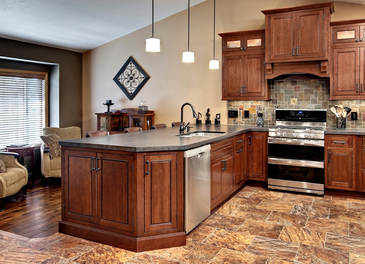 the kitchen cabinets are the fairmont inset style from in the cherry russet
