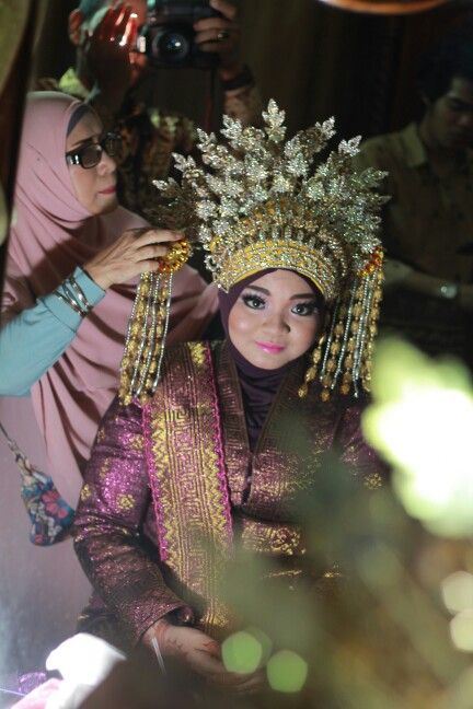 "Its more like a crown for me. But its called "" sunting "" that means a crown for bride. Its malayan culture"