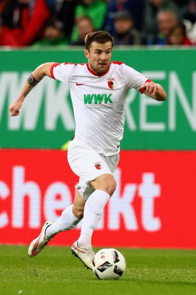 Daniel Baier of Ausgburg runs with the ball during the Bundesliga match between FC Augsburg and Hertha BSC at WWK Arena on November 19, 2016 in Augsburg, Germany.