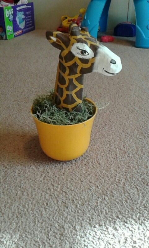 Paper machete giraffe head in a flower pot with fake moss. Perfect for my daughter's nature themed room.