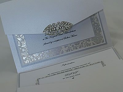 Google Image Result for http://www.imaginewedding.co.uk/images/Majestic_vintage_style_wedding_stationery_with_crystal_brooch.jpg