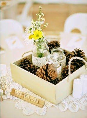 Homemade Wedding Centerpiece Ideas For the Budget Conscious Bride: Pine Cones & Flowers. http://simpleweddingstuff.blogspot.com/2014/07/homemade-wedding-centerpiece-ideas-for.html