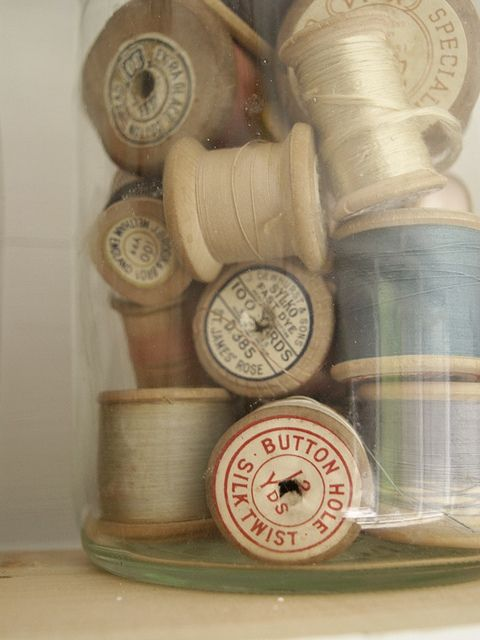 Have a lot of wooden spools of threads left over from my grandmother's and aunt's stashes...I should show them in a display like this one, I'm thinking!  MB