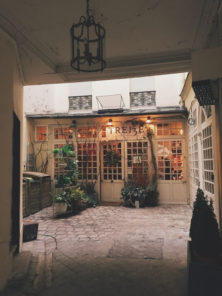Tell your girlfriends to meet you at the prettiest flower shop in Paris– but only the onesyou trust with your innermost secrets. We've found ourselves a hidden new lunch spot...  Wait for her by the tulips stacked on top of old books...  Next to one of the oldest tabac shops in Paris on