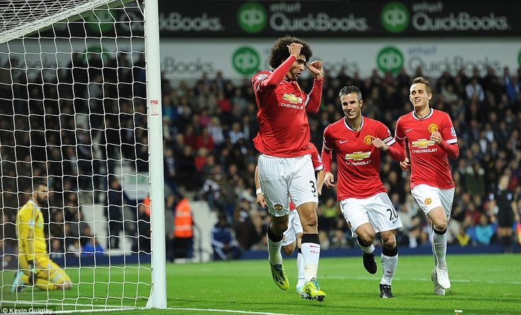 Fellaini leads the celebrations after hauling United level immediately after the break at the Hawthorns